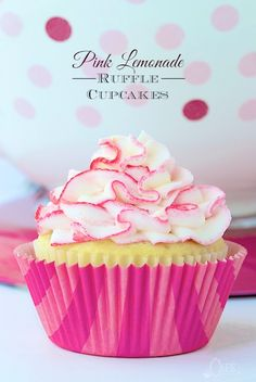 Pink Lemonade Ruffle Cupcakes - Super moist, lemony cupcakes studded with bits of delicious raspberry - a flavor match made in heaven! Oh and the crème de la crème? A super fun, crazy good lemon buttercream ruffles tinged with pink (or any color you choose).