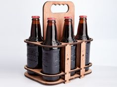 Lasercut wooden six-pack holder.