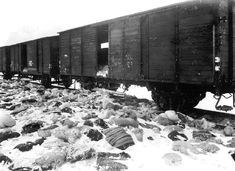 View of the abandoned train in Auschwitz-Birkenau, Poland that was on the way to Germany loaded with the personal effects of Auschwitz victims. Some of the freight lays scattered and partially buried in the snow outside the train in February, 1945