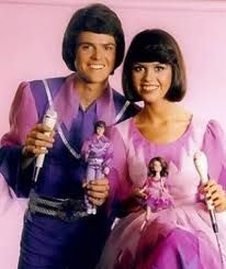Donny and Marie dolls. Had them and loved all the clothes, especially Donnie's purple socks!