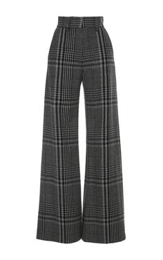 Rendered in wool, these **Vilshenko** trousers feature a high waist, a wide leg, and an all over hounds tooth check print.