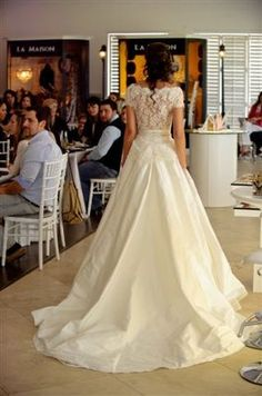 """South African wedding dress made by Hendrik Vermeulen. It comes from his """"La Vie en Roses"""" collection and the dress itself is called """"Charme de Paris."""" It is around $3,800"""