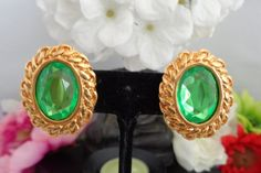 Coupon Code 050116 -  Kenneth J Lane (KJL) Vintage Apple Green Rhinestone Earrings Set in Goldtone Price is $22.The earrings can be seen in our store at www.CCCsVintageJewelry.com Have a great vintage day. Best, Coco