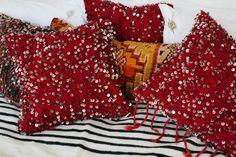 Stunning deep red wool wedding blanket cushions with hand sequining with steel cut sequins on both sides.  Exclusive to the M.Montague Souk. Moroccan design