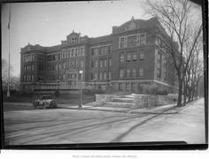Westport High School - Full, street level exterior view of Westport High School located at 315 E. 39th Street.  A nine-hole golf course was once laid out in the area where Westport High School now stands, with the ninth hole located at 36th and Gillham.  It was rather rough, as golfers were often bothered by cows grazing on the greens.