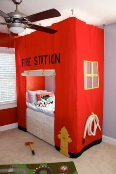 Fire station bed I sewed for my son, along with soft axe and fire-hose. (Inspired by utahcountymom.com Fire Station Card Table Tent). SewVera on Etsy.