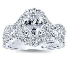 Gabriel & Co. - 14k White Gold Diamond Halo Engagement Ring with matching Wedding Band.