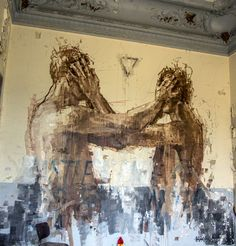 After a beautiful piece last Friday (covered), Borondo is back in Paris where he just completed yet another new piece. Armed with his paint-stick roller, the Spaniard quickly painted this brilliant large-scale mural of two men covering each others faces.