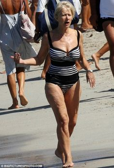 While still in excellent shape for her age, she has swapped the bikini for a more sedate striped black and white one-piece costume.
