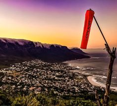 The windsock on the side of Lion's Head from where the paragliders and windsurfers launch over Clifton.  #windsock #CampsBay #LionsHead #Clifton #sea #ocean #12Apostles #mountain #mountains #sunrise #sunrise_sunsets_aroundworld #sunrises #GoldenHour #beach #shore #CapeTown #CityOfCapeTown #CapeTownMag #AmazingCapeTown #CityOfCapeTownSkies by rumin0 http://ift.tt/1ijk11S