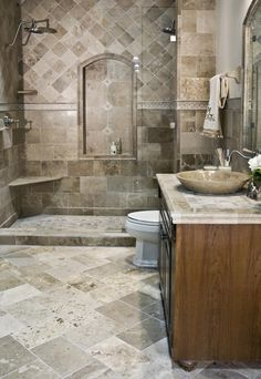 This driftwood travertine was installed in 2008 and still looks stunning! #tile #thetileshop #travertine