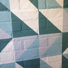The painted #blue triangle #pattern dresses up the brick patio #walls at Avalon @Bevvvvverly Hills