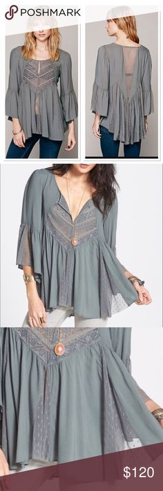 FREE PEOPLE SWEET EMOTION SWING TOP NWT$148 SMALL Billowy dotted jacquard top with dotted mesh and embroidered lace insets. Bell sleeves. Keyhole at neckline with hook and eye closure.  *100% Rayon *Contrast: 100% Nylon *Machine Wash Cold *Import Free People Tops Tunics