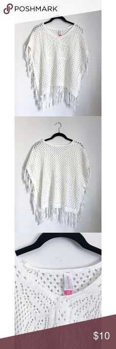 White/ Cream Fringe Cozy Knit Poncho Soft. Comfortable. Fringe edges. Wide arm holes. Design on front. Flowy. Somewhat warm. Made in China.  L: 21 in W: 23 in  100% Acrylic   Offers accepted.  All clothing shipped pre-ironed/ washed/ lint-rolled. All items comes from a smoke-free & pet-free home. No Boundaries Sweaters Shrugs & Ponchos