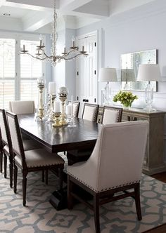 Love the icy blue tones and dark wood dining room