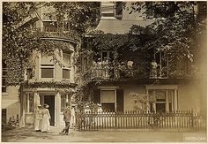 """Woman Suffrage Headquarters [Congressional Union for Woman Suffrage], Washington, 07/1917. Photo shows the woman suffrage headquarters in Washington, District of Columbia, from which the White House """"pickets"""" set forth, bearing banners inscribed with mottoes advocating suffrage."""