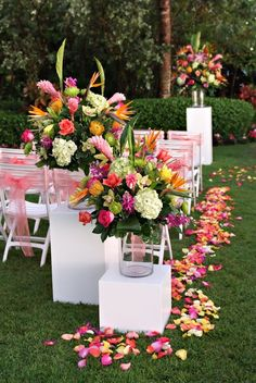 These tropical beach colors are gorgeous and perfect for a beach wedding! The flower petals, wedding chairs and flower arrangements are so bright, colorful and happy. weddings A Modern and Tropical Destination Wedding in Naples, Florida Table Decoration Wedding, Beach Wedding Decorations, Wedding Table Centerpieces, Wedding Chairs, Reception Decorations, Flower Decorations, Table Decorations, Flower Centerpieces, Hawaiian Centerpieces