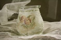 A candle jar with decoupage and semi transparent technique