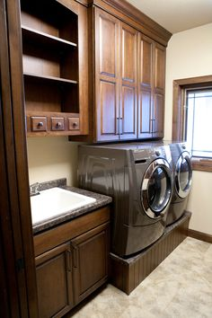 New construction laundry room in Stevens Point, Wisconsin. Designed by Janet Plier with Welling Woodworks in Stevens Point, Wisconsin. StarMark Cabinetry Breckenridge door style in Cherry finished in Nutmeg with Ebony glaze.