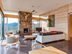 dream house interiors, stone fireplace, living room, room with a view, chairs