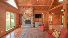 Since 1923 Ward Cedar Log Homes has been providing custom log homes and log cabins. View detailed log home plans & kits and build your next home with Ward whether it's a log or hybrid/timber home. Log Home Plans, House Plans, Cedar Log, Rock Fireplaces, Timber House, Beautiful Rocks, Next At Home, Sitting Area, Large Windows