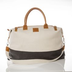 The perfect weekender bag for any adventure. Large enough to fit several outfits and small enough to throw in your passanger seat, this cream cotton bag features a long removable strap, leather accent