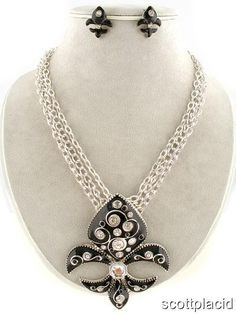 """CHUNKY 3.10"""" LONG METAL FLEUR DE LIS PENDANT BLACK AND SILVER TONE NECKLACE SET WITH CRYSTAL ACCENTS    * If you need a necklace extender I have them for sale in my store.*         POST EARRINGS      NECKLACE: 16"""" LONG + 3"""" EXT       COLOR: BLACK AND SILVER TONE $21.99"""