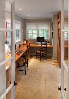 Great way to make a long, narrow, but fairly small room become productive... but I would have to go for more comfortable chairs, just sayin'...