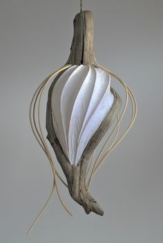 Summer style!! Organic flowing shape with fabric and gray drift wood! Lightness driftwood chandelier! Imagine this in a stairwell of a lovely beach house cottage by the ocean!