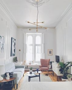 Those windows + that chandelier = ✨ @livingbyLo's Quebec apartment is all about mixing old and new.  Follow the link in profile to get the full tour of this space. #mywestelm