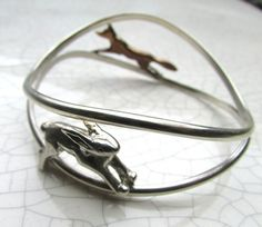 Xuella Arnold - Fox and hare bangle Xuella Arnold will be exhibiting at BCTF 2017 on Stand Bangles, Bracelets, Hare, Fox, Trade Fair, Bronze, Sterling Silver, British, Jewellery