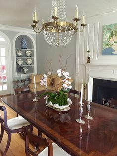 Southern grey dining room, orchid in a shell, Lulie Wallace painting, French chandelier