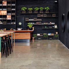 Four Pillars Gin Distillery - Like the floor, black wall panels