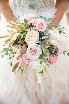 We are totally SWOONING over this stunning Lazaro wedding dress from Delica Bridal, and that's only the beginning of all the amazing details this shoot has to offer! Beautifully coordinated by Jillian Nowell Events and Marketing Inc, blush, gold and grey are used to create the perfect atmosphere of elegance and glamour. See all the blush and gold glam wedding ideas here from NC Photography.Photographers: NC PhotographyCakes & Catering: The Art Of CakeFlowers: Studio BloomFashion: Deli...