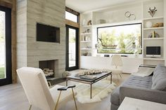 Designs by Sundown is a 2020 Gold List honoree featured in Luxe Interiors + Design. See more of this design professional's projects. Simple Fireplace, Fireplace Design, Concrete Fireplace, Fireplace Cover, Freestanding Fireplace, Limestone Fireplace, Fireplace Hearth, Fireplace Ideas, First Apartment Decorating
