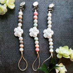 Camellia Flower Girl silicone beaded pacifier clips. Available at www.etsy.com/shop/louloulollipopfinery