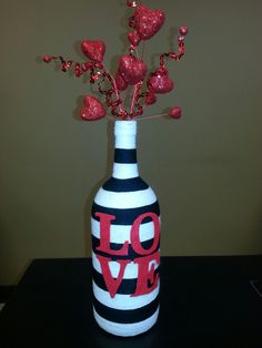 Recycled wine bottle decorated for Valentine's Day! Recycled wine bottle decorated for Valentine Liquor Bottle Crafts, Recycled Wine Bottles, Wine Bottle Art, Painted Wine Bottles, Decorated Wine Bottles, Diy Bottle, Glass Bottles, Vodka Bottle, Perfume Bottles