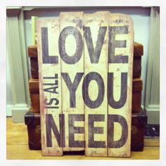 Love is all you need wall hanging available at The vintage tea party co