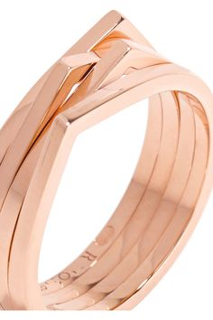 Third-generation Parisian jeweler Gaia Repossi is famed for her sleek, minimal designs. This 18-karat rose gold ring is formed of angled bands, giving it depth and dimension. Wear it on your middle finger.