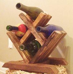He encontrado este interesante anuncio de Etsy en https://www.etsy.com/es/listing/218146462/wood-wine-rack-tabletop-wine-rack-small