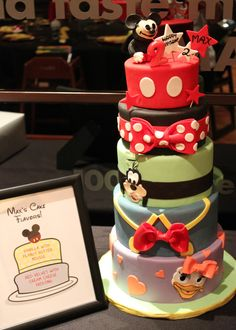 5-tier Mickey Mouse clubhouse themed cake.  Mickey, Minnie, Goofy, Donald, and Daisy.  www.peridotsweets.com