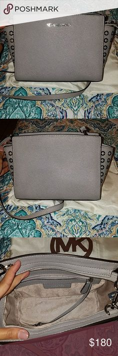 Michael kors Selma crossbody bag Super cute crossbody. Gray with silver hardware. Has cute silver detailing on both sides. Can be used as shoulder or crossbody. Comes with dust bag. No stains or tears. Michael Kors Bags Crossbody Bags