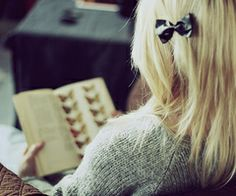 reader with a bow