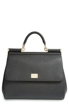 Free shipping and returns on Dolce&Gabbana 'Miss Sicily' Satchel at Nordstrom.com. Impeccably crafted and as versatile as it is beautiful, the Miss Sicily is a bag for all seasons. Made from rich, grained leather, this satchel features a spacious interior with plentiful pockets, a rolled top handle for toting and a removable strap for over-the-shoulder wear. Covered dowels, gleaming hardware and the Dolce&Gabbana logo plaque provide polished detailing.