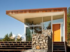 The Hill House by David Coleman Architecture is located in Winthrop, Washington and boasts a fabulous view, cool deck firepit and warm wood interiors. Gabion Stone, Wood Stone, Gabion Wall, Garden Design, House Design, Deck Design, House On A Hill, Mid Century House, Architecture Design