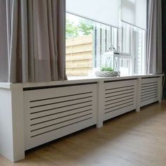 15 Stylish Ideas How To Cover Your Radiators Whether your home is decorated modern or traditional, mask for the radiator is one of the details that will give to any room a special character. In order Best Radiators, Modern Radiator Cover, Built In Electric Fireplace, Classic Cabinets, Home And Living, Sweet Home, New Homes, Home Appliances, House Design