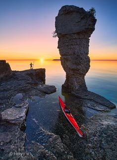 Sunrise at Flowerpot Island - Self-Portrait taken with a wireless remote with 5 seconds delay  Sunrise at Flowerpot Tried this five years ago but I missed the first light of sunrise because I was on a slow inflatable kayak. Now I have my 17-foot sea kayak and I arrived 12 hours before the sunrise! The water was crystal clear I couldn't help but did a dozen Greenland rolls right beside this flowerpot. — feeling happy at Fathom Five National Marine Park.