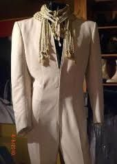 This is the first actual jumpsuit Elvis wore. It is called the White Cossack jumpsuit. Elvis wore it during the January - February 1970 Las Vegas run.