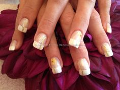 Acrylic nails with white French polish and yellow flowers as nail art