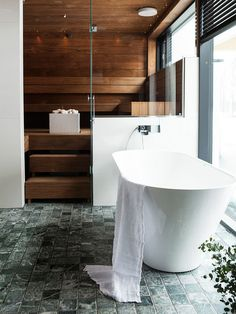 Concrete floors and a black-and-white bathroom were at the top of their wish list, when the family in Rovaniemi, in Finnish Lapland, started building their house on the Kemijoki river. But an interior designer overturned their ideas right away. Marble Bathroom Floor, White Bathroom, Concrete Floors, Plywood Floors, Concrete Lamp, Stained Concrete, Concrete Countertops, Laminate Flooring, Spa Interior Design